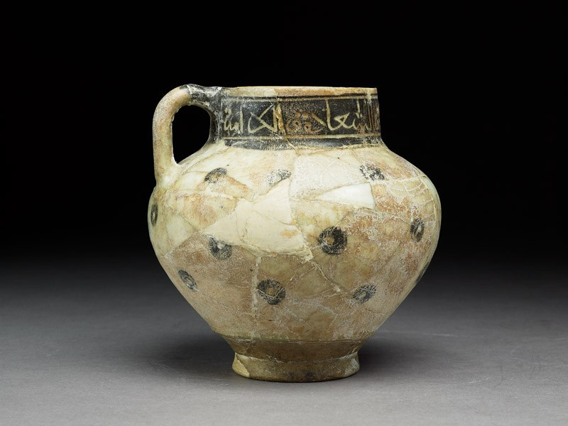 Jug with circles and inscription