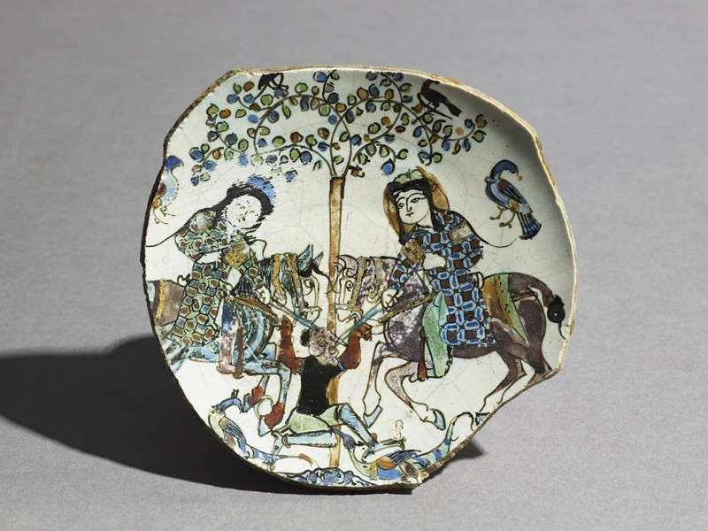 Base fragment of a dish with two men on horse-back fighting a non-human creature (EA1978.2423, top             )