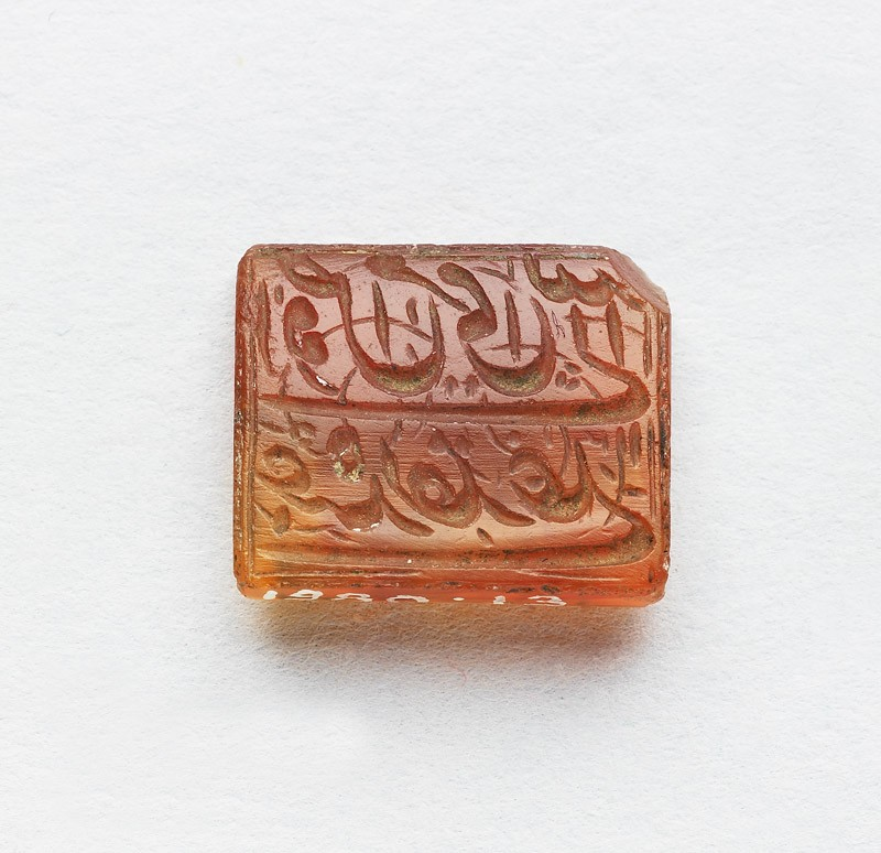 Rectangular bezel seal with nasta'liq inscription and floral decoration on both sides