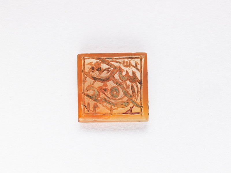 Square bezel seal with nasta'liq inscription and spiral decoration (front           )