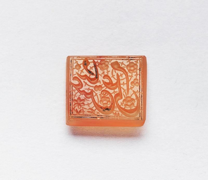 Rectangular bezel seal with nasta'liq inscription and floral decoration (front           )