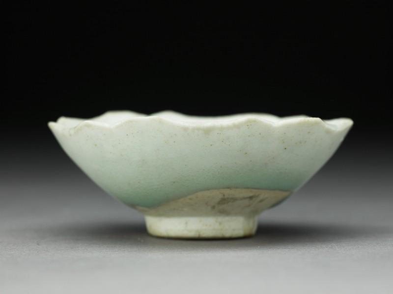 White ware cup with foliated rim