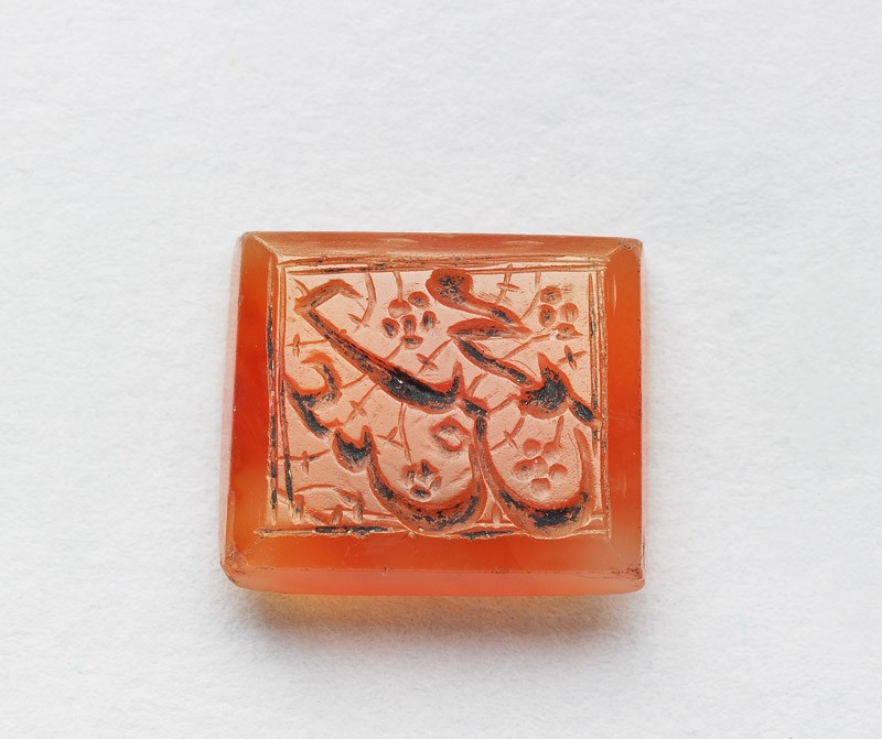 Rectangular bezel seal with nasta'liq inscription and floral decoration (EA1980.8, front          )