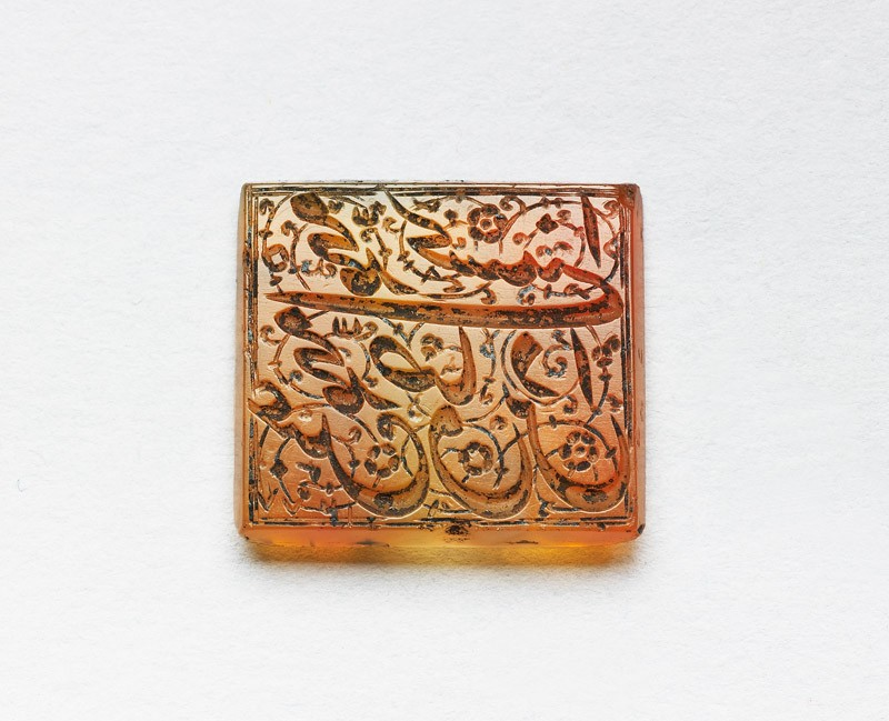 Rectangular bezel seal with nasta'liq inscription and floral decoration (EA1980.9, front          )