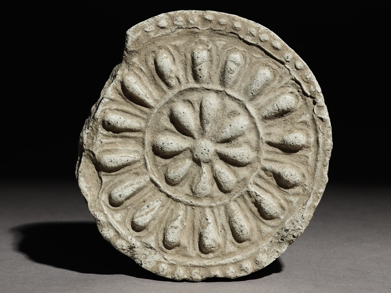 Circular roof end-tile with floral decoration (EA1983.234, front            )