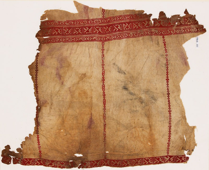 Textile fragment from a tunic with geometric bands