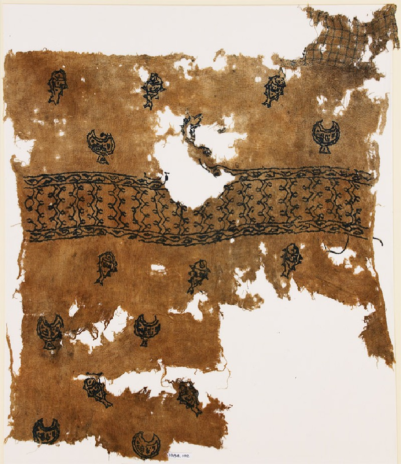 Textile fragment with chalices, fish, and inscription