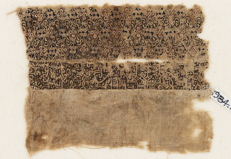 Textile fragment with quatrefoils and interlacing kufic script (EA1984.108, front            )