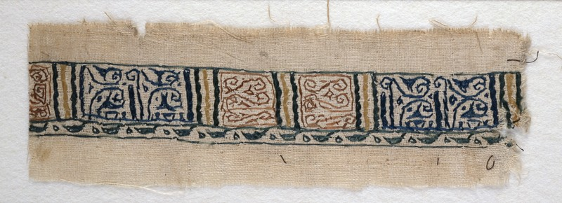 Textile fragment with band of pseudo-inscription, leaf-shaped finials, and tendrils