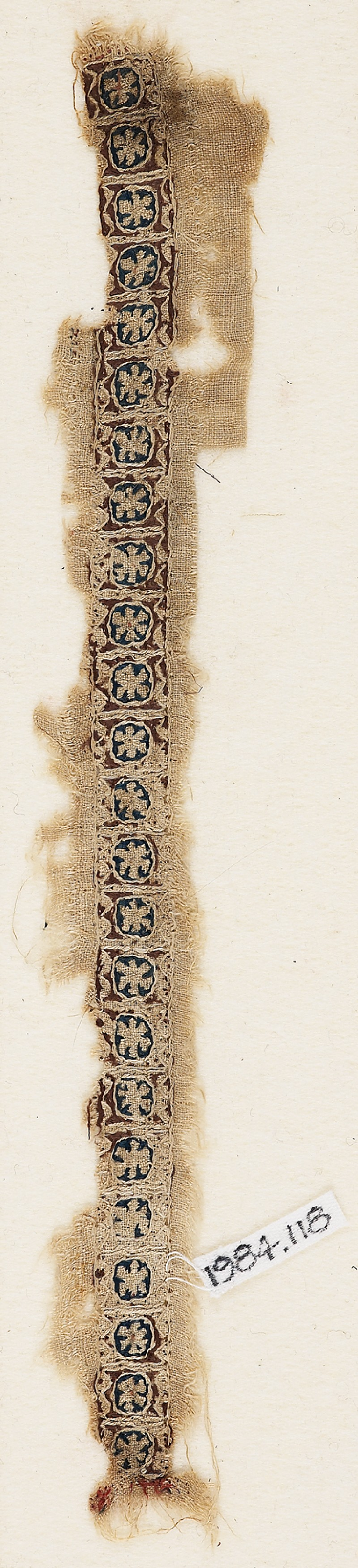 Textile fragment with circles and rosettes
