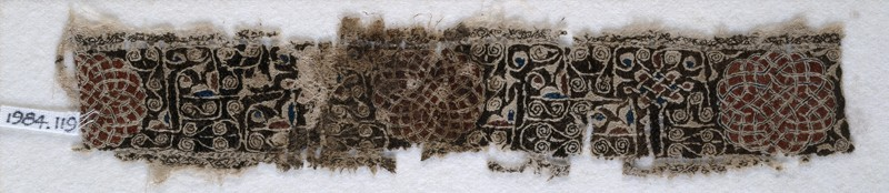 Textile fragment with interlacing scrolls and knotted pattern