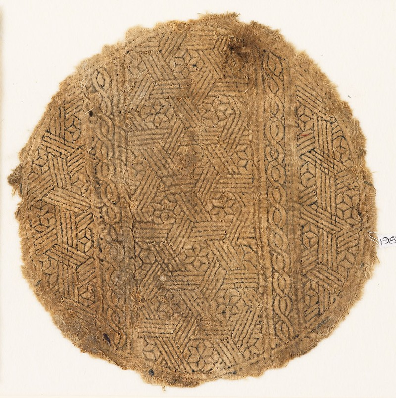 Roundel textile fragment with interlace and lozenges