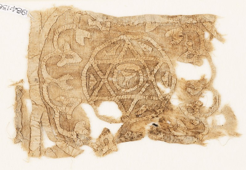 Textile fragment with roundel, star, and chalice (front            )