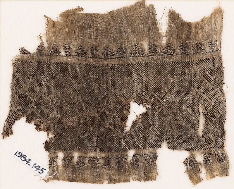 Textile fragment with band of hooks and diamond-shapes