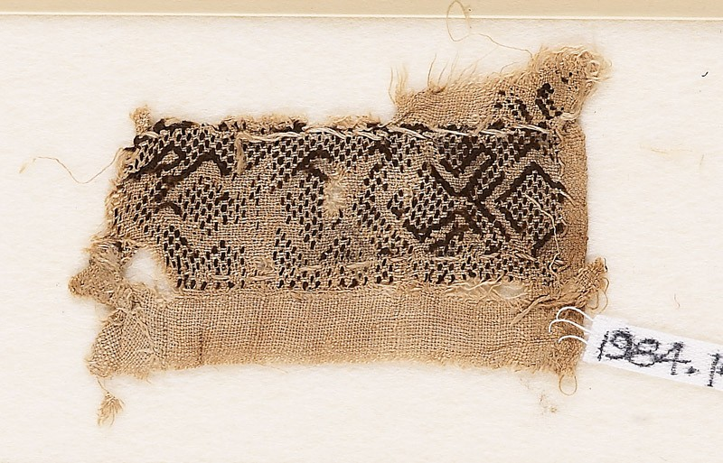 Textile fragment with hooked chevrons (front            )