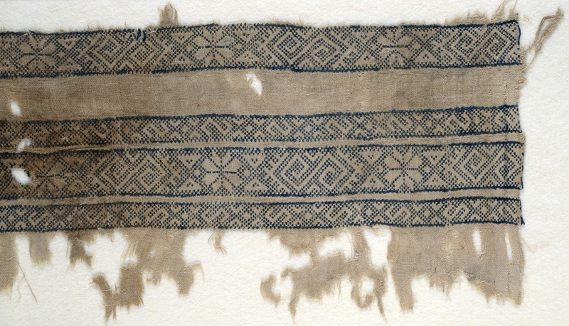Textile fragment with bands of inverted hooks, flowers, and triangles (EA1984.154, front            )