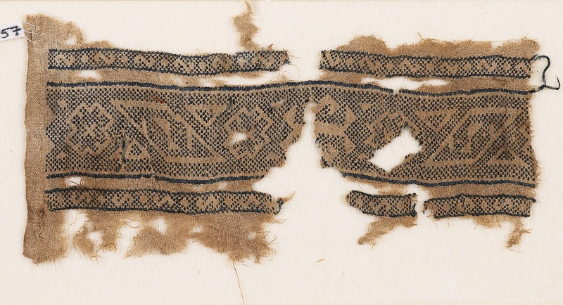 Textile fragment with bands of lozenges, stepped diamond-shapes, and triangles (EA1984.157, front            )
