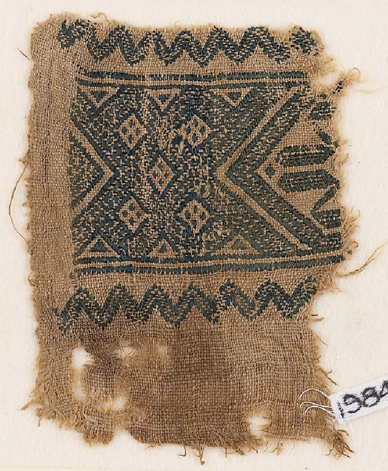 Textile fragment with interlace of squares