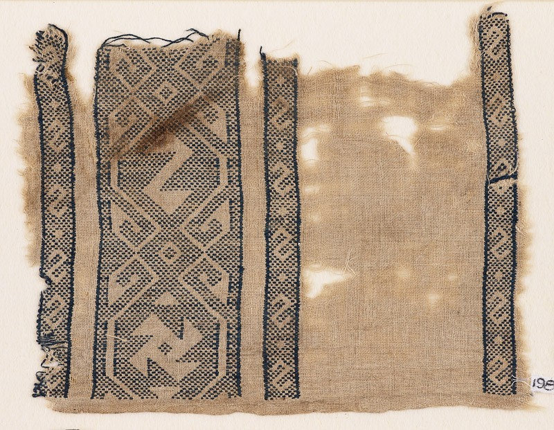Textile fragment with reversed S-shapes and a spiral (EA1984.165, front            )