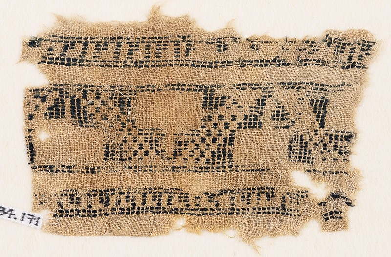 Textile fragment with stepped rectangles and remains of inscription