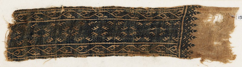 Textile fragment with linked diamond-shapes and stylized vines (front            )