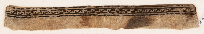 Textile fragment from a garment with stepped S-shapes (EA1984.178, front            )