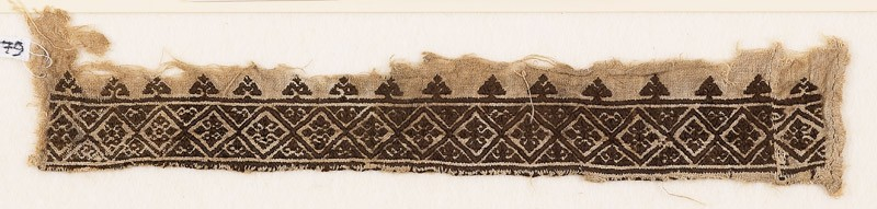 Textile fragment with diamond-shapes and floral quatrefoils, probably from a garment (EA1984.179, front            )
