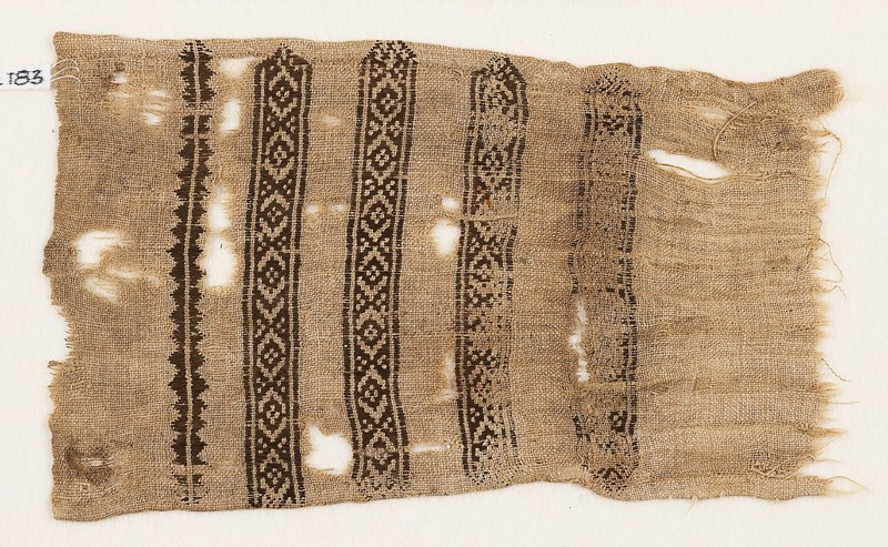 Textile fragment with diamond-shapes and triangles