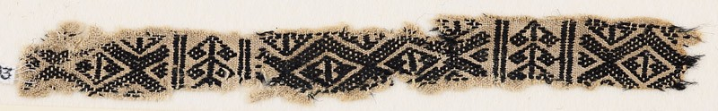 Textile fragment with linked-diamond shapes and stylized plants (front            )