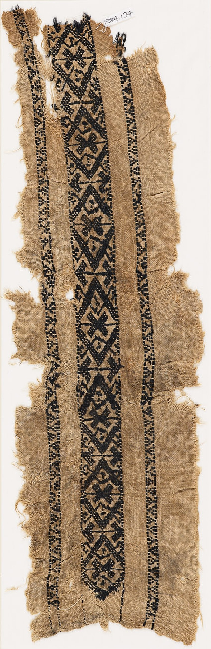 Textile fragment with diamond-shapes and arrows