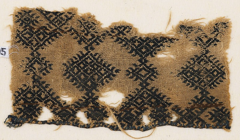Textile fragment with linked diamond-shapes and hooks (EA1984.195, front            )