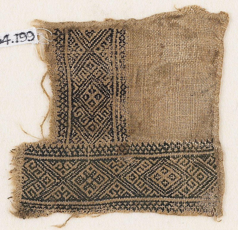 Textile fragment with linked diamond-shapes (front            )