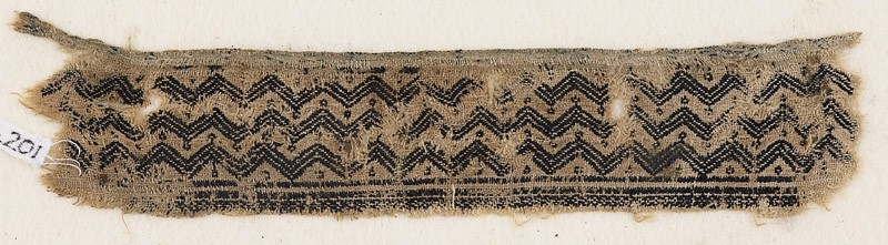 Textile fragment with chevrons and circles