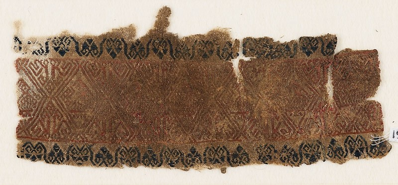 Textile fragment with linked diamond-shapes and possibly birds (EA1984.209, front            )