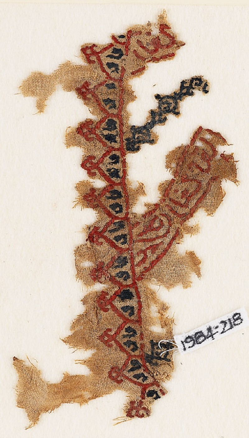 Textile fragment with linked crenellations and inscription