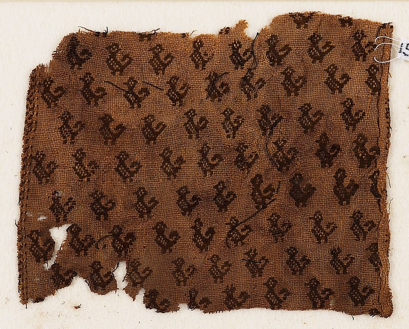 Textile fragment with birds with curving tails, probably from a tunic (front            )