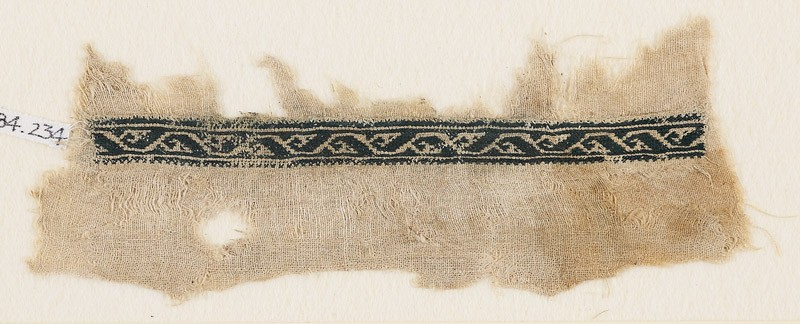 Textile fragment with vine and stylized leaf or tendril (front            )