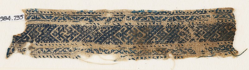 Textile fragment with diamond-shapes, spirals, and stylized tendrils (EA1984.235, front            )