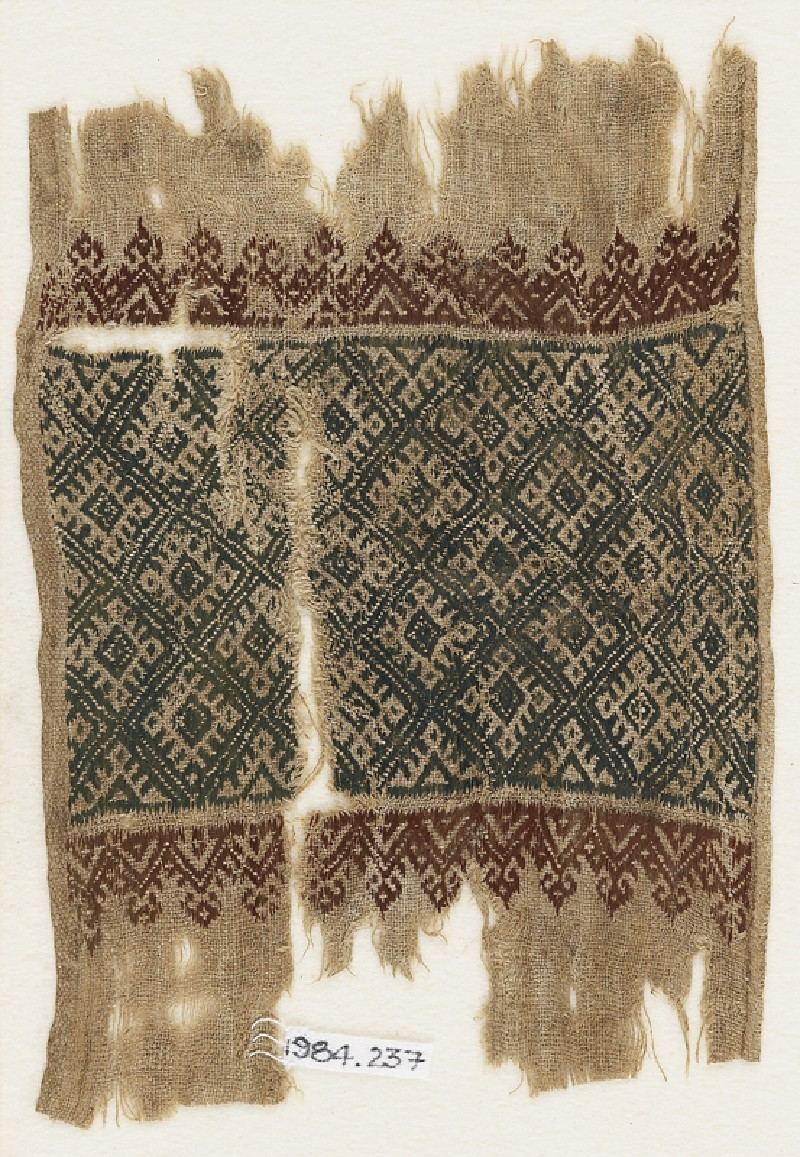 Textile fragment with linked diamond-shapes, triangles, and palmettes (EA1984.237, front            )