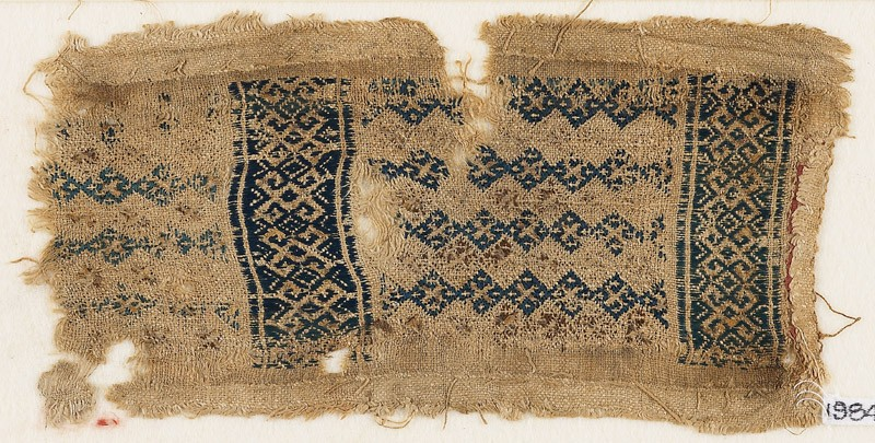 Textile fragment with linked diamond-shapes, hooks, squares, and crosses