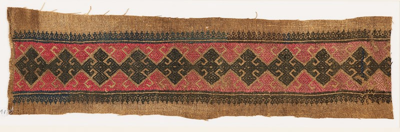 Textile fragment with diamond-shapes, triangles, and floral shapes (front            )