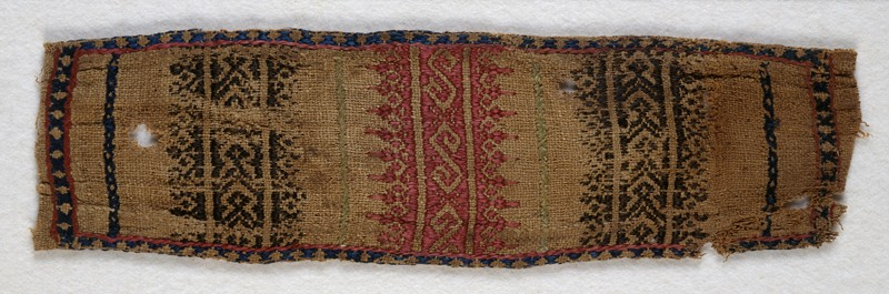 Textile fragment with S-shapes and stylized leaves, possibly a trouser tie-belt (front            )