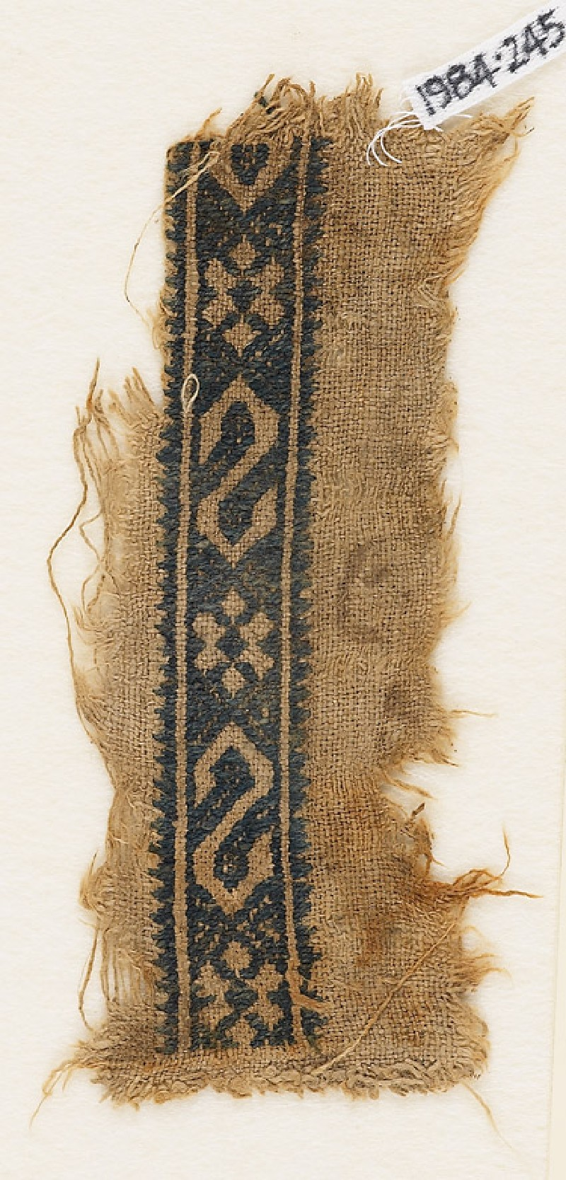 Textile fragment with S-shapes and rosettes