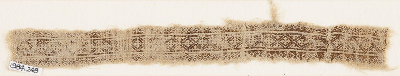 Textile fragment with linked diamond-shapes and quatrefoils (front            )