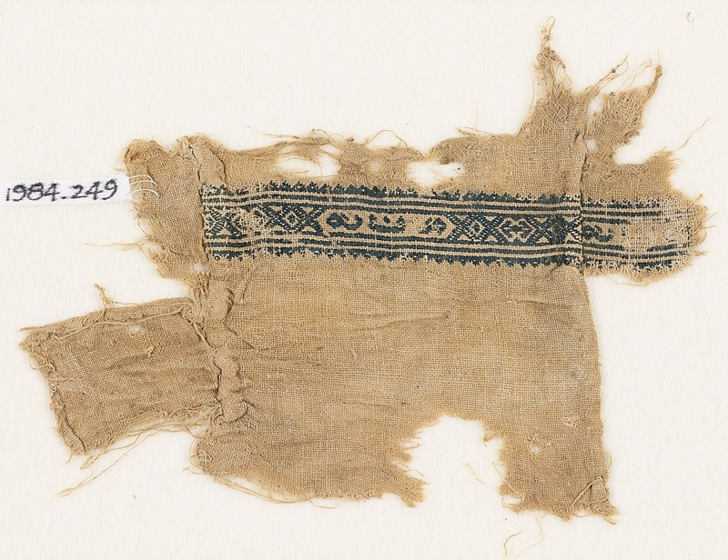 Textile fragment with hexagons, inscription, and diamond-shapes (EA1984.249, front            )