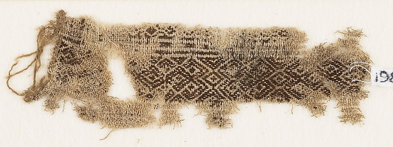 Textile fragment with linked diamond-shapes and hooks (EA1984.251, front            )