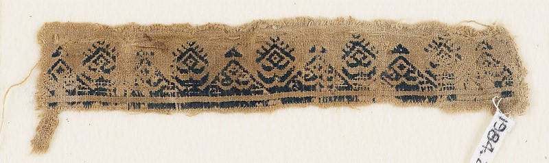 Textile fragment with triangles, inscription, diamond-shapes, and crescents (EA1984.255, front            )