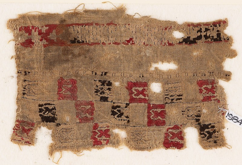 Textile fragment with squares and pseudo-inscription (EA1984.260, front            )