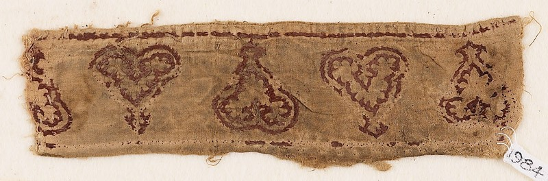 Textile fragment with leaves and palmettes, possibly from trousers or a collar (EA1984.263.a, front              )