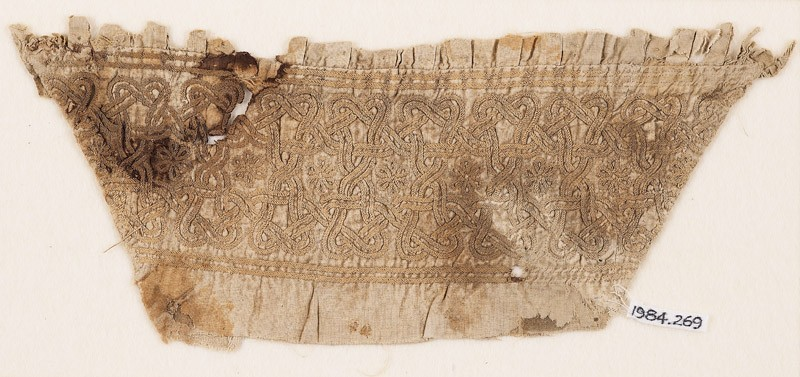 Textile fragment from a sleeve, with interlace, linked stars, and rosettes (EA1984.269, front            )